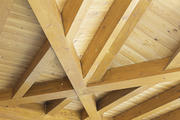 Hardwood structure on the roof of a house, decoration and construction